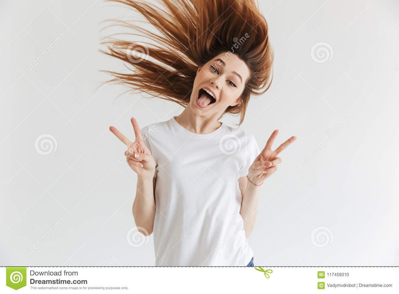 Happy screaming woman in t-shirt showing peace gestures