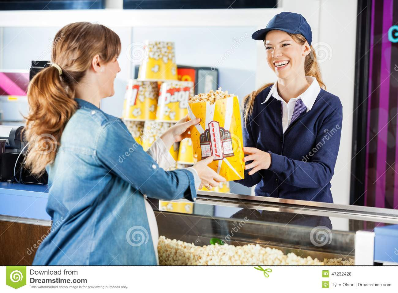 Happy Seller Giving Popcorn To Pregnant Woman At Stock ...