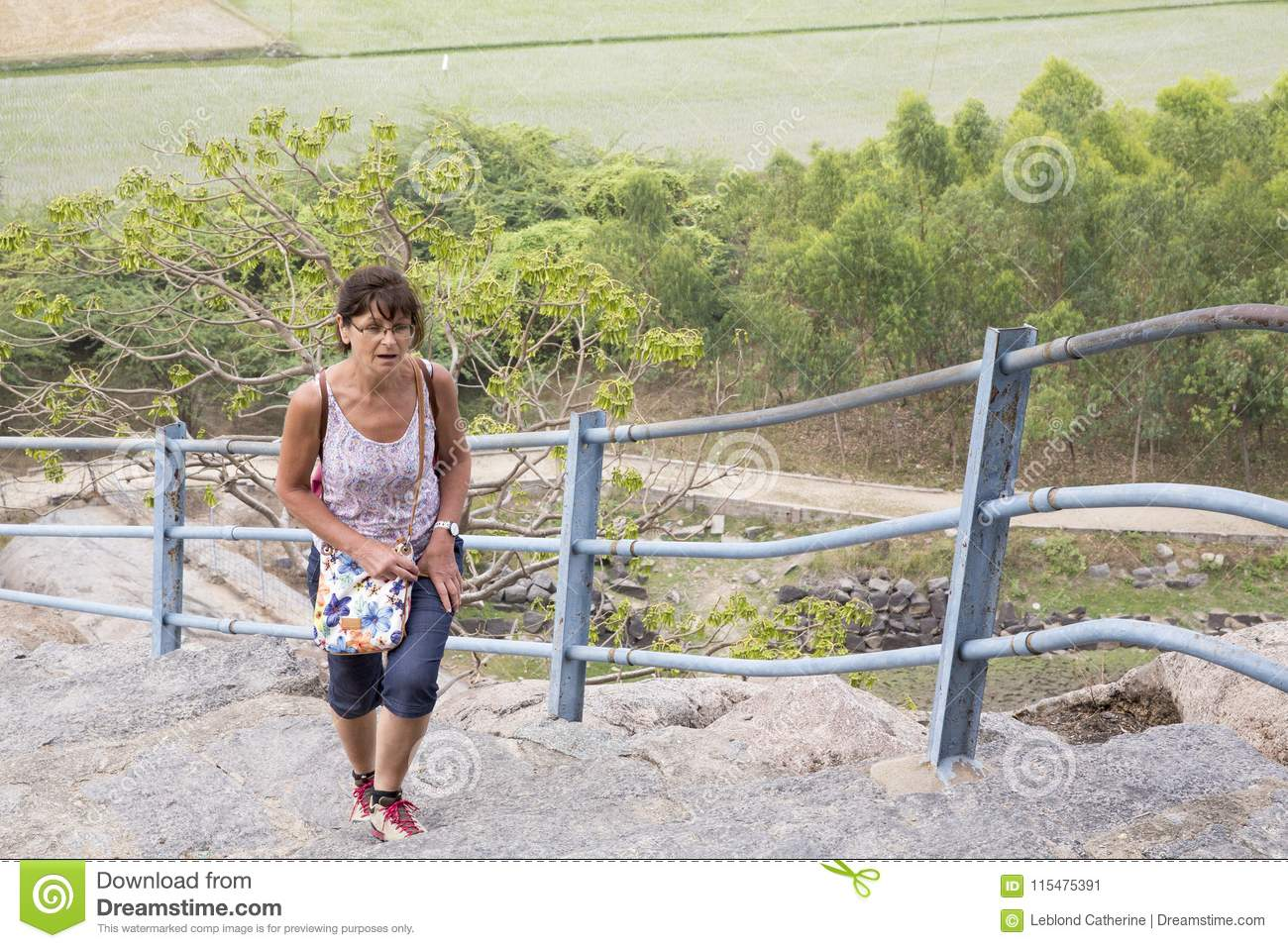 Happy Senior Adult Woman Tourist Clumbing Up The Steps At Gingee