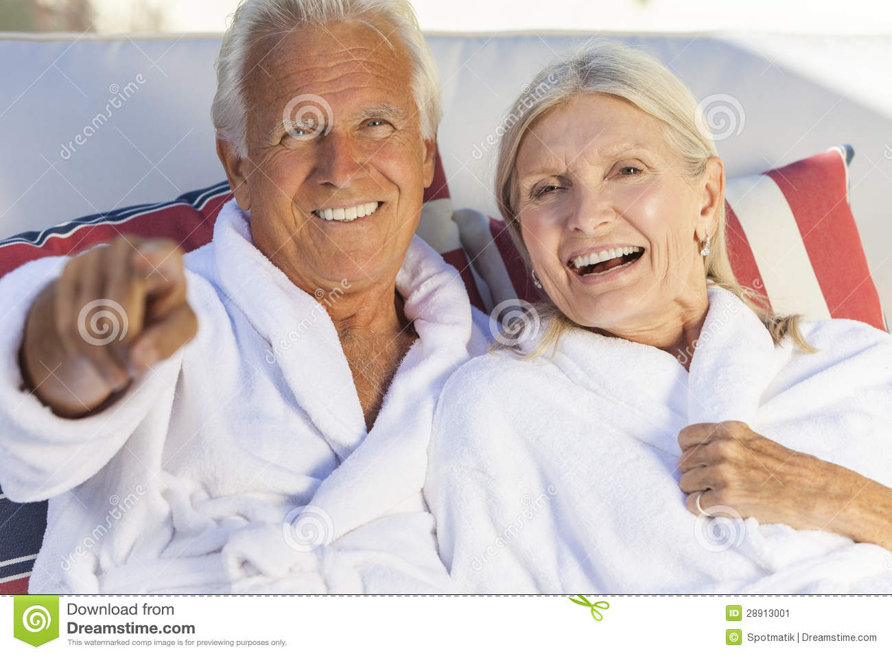 Happy senior couple in bathrobes at health spa stock image for Health spa vacations for couples