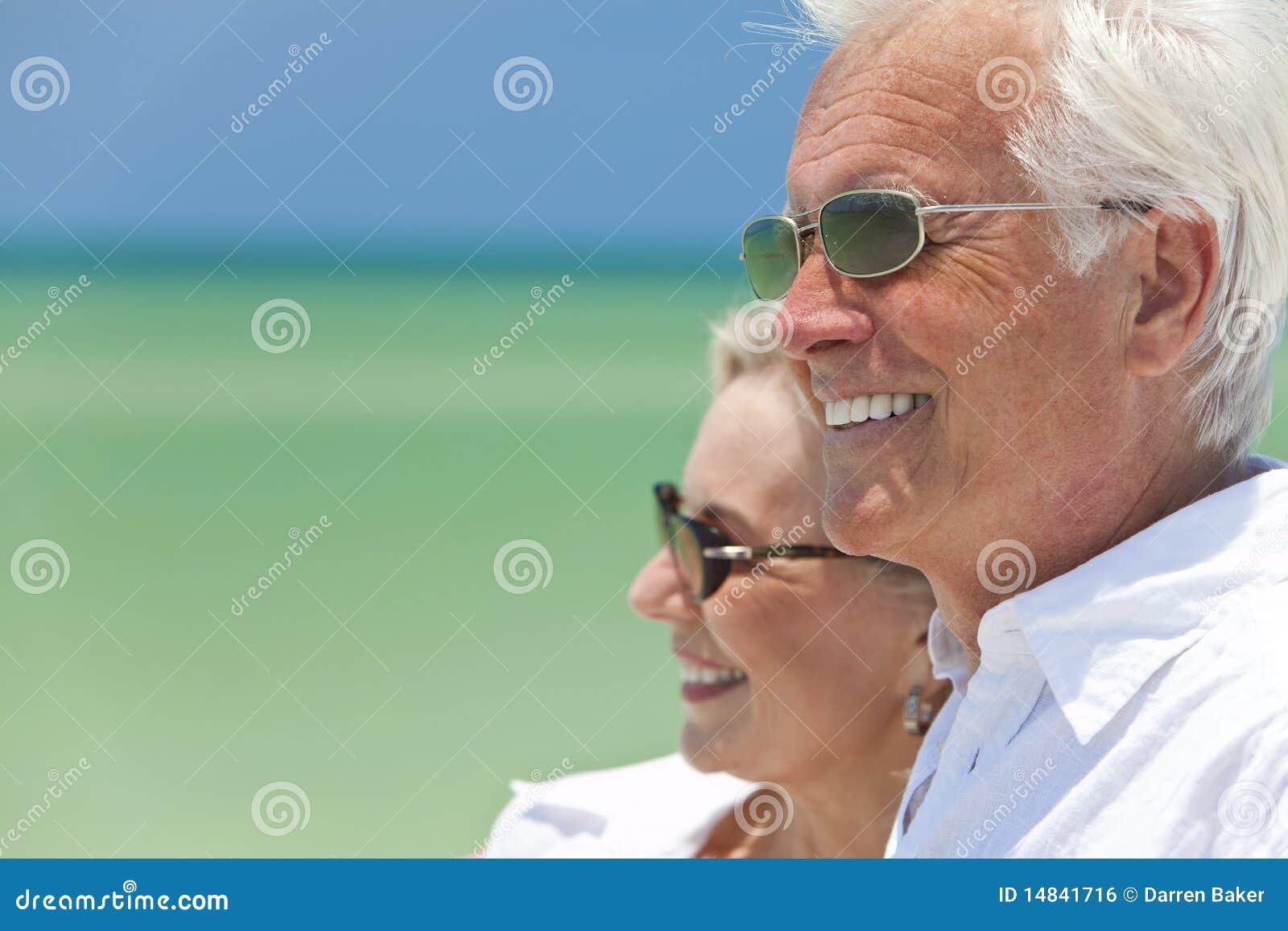 Happy Senior Couple By the Sea on A Tropical Beach