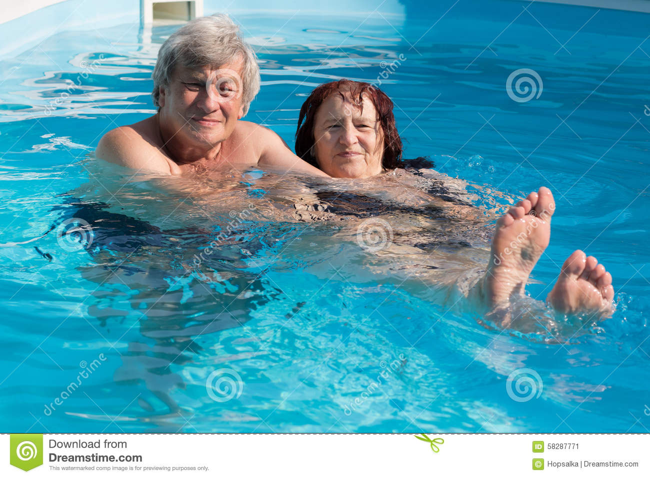 Happy senior couple in a swimming pool