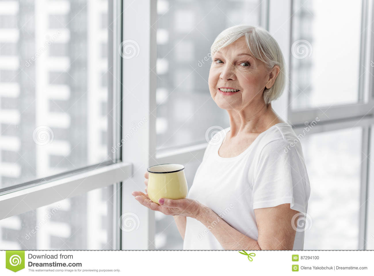 happy senior lady enjoying hot drink stock photo - image of