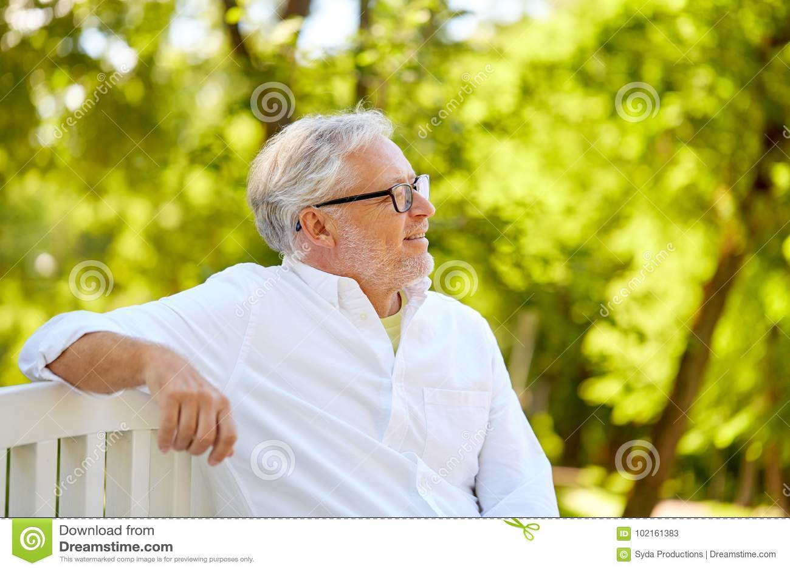 aa532bf69cf19 Happy Senior Man In Glasses Sitting At Summer Park Stock Image ...