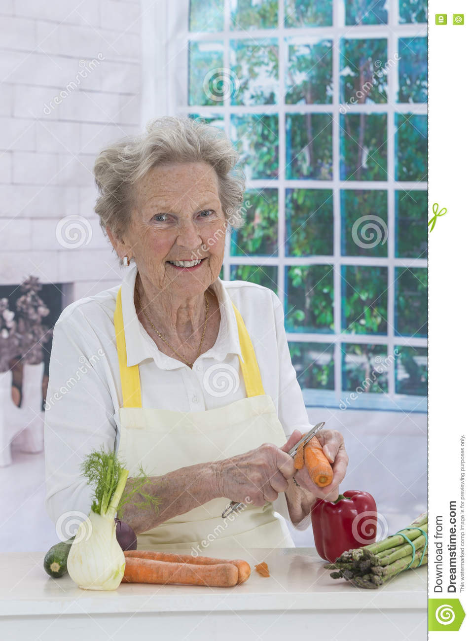 Happy Senior Woman Cooking In Kitchen Stock Image - Image of ...
