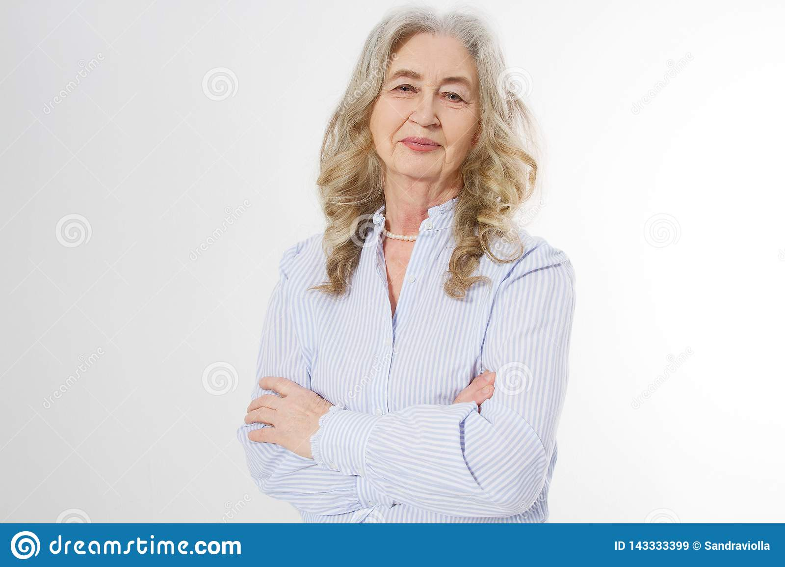 Happy senior woman with crossed arms on white background. Positive elderly seniors life living and european old beauty