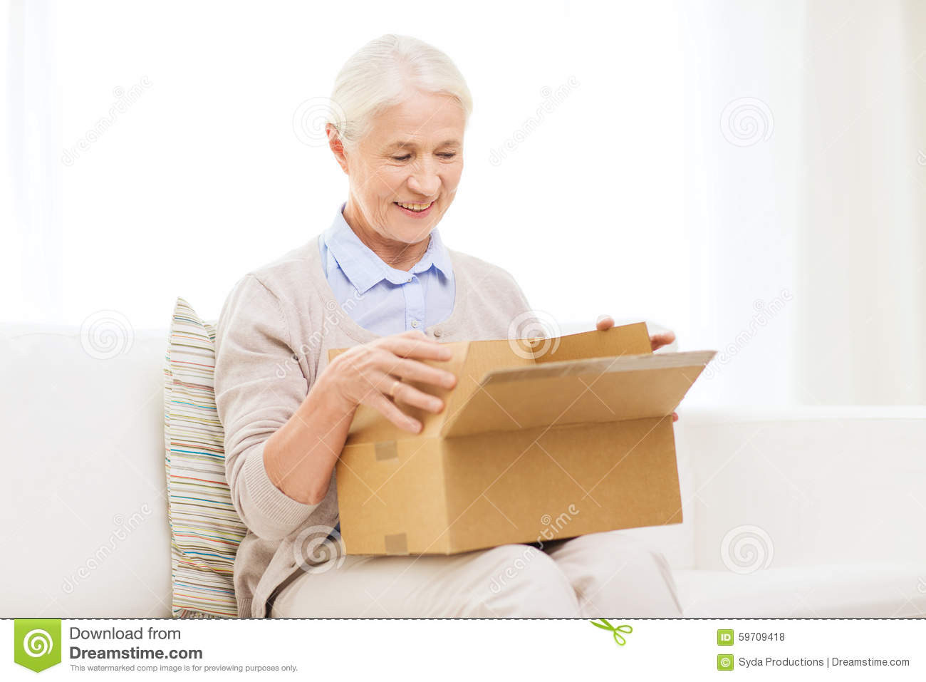 Happy Senior Woman With Parcel Box At Home Stock Photo ...