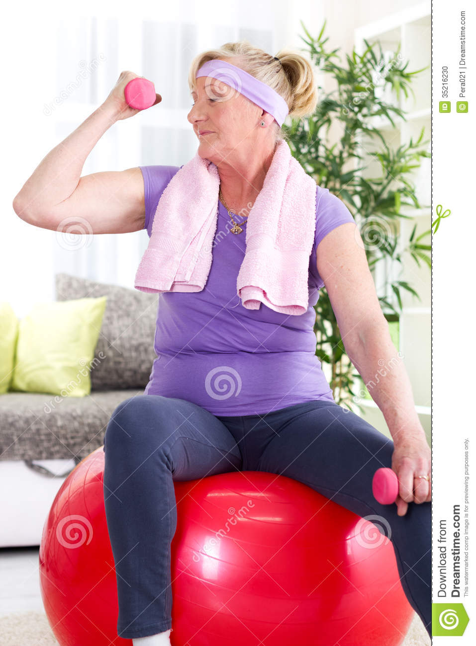 naked woman sitting on gym ball