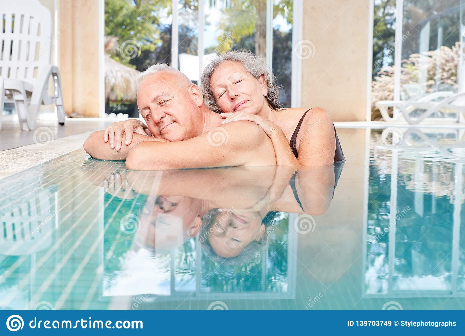Senior couple is sleeping peacefully in the pool