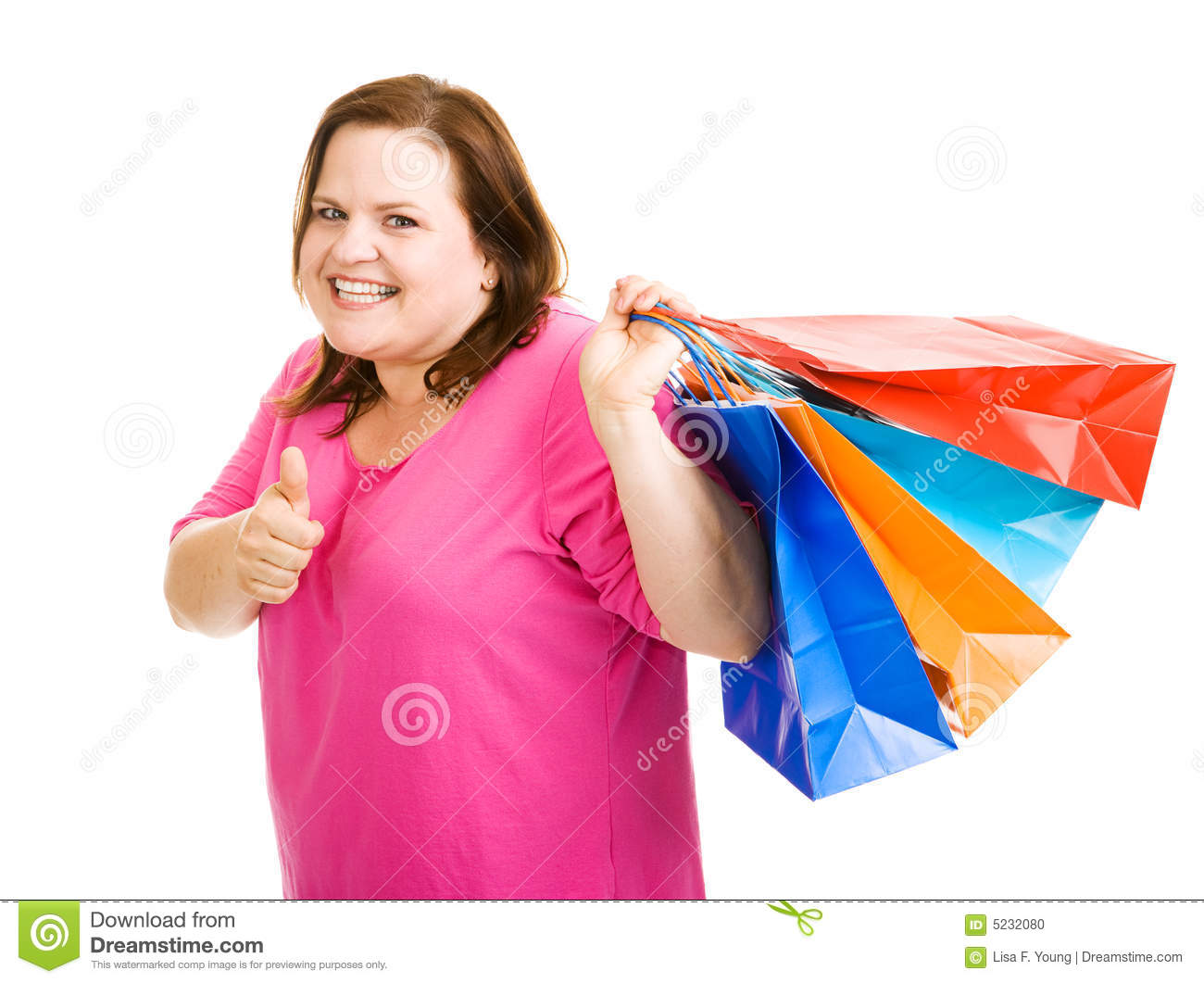 ... her shopping bags and giving a thumbs-up sign. Isolated on white