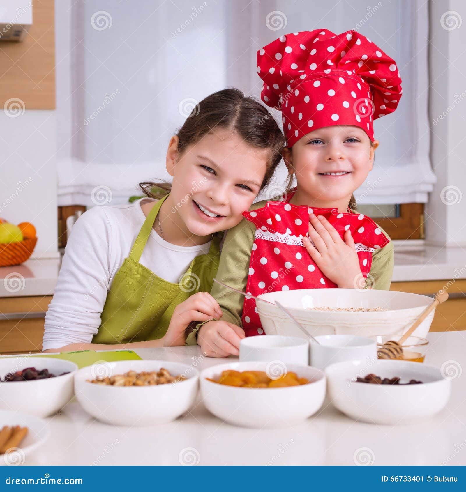 Happy Girl Kitchen: Girl Preparing Granola Stock Photo