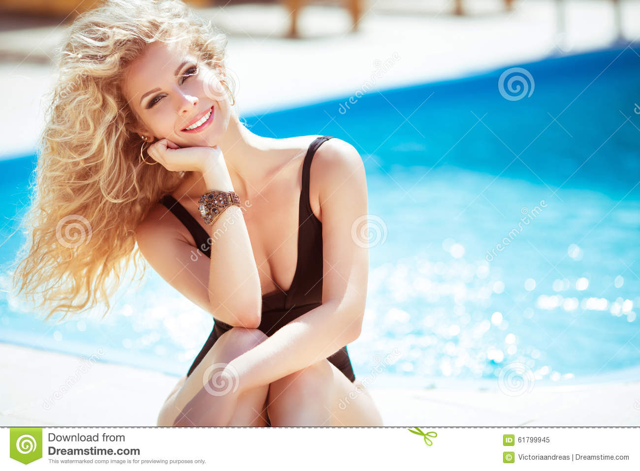 Happy smiling attractive blond woman over blue water swimming po