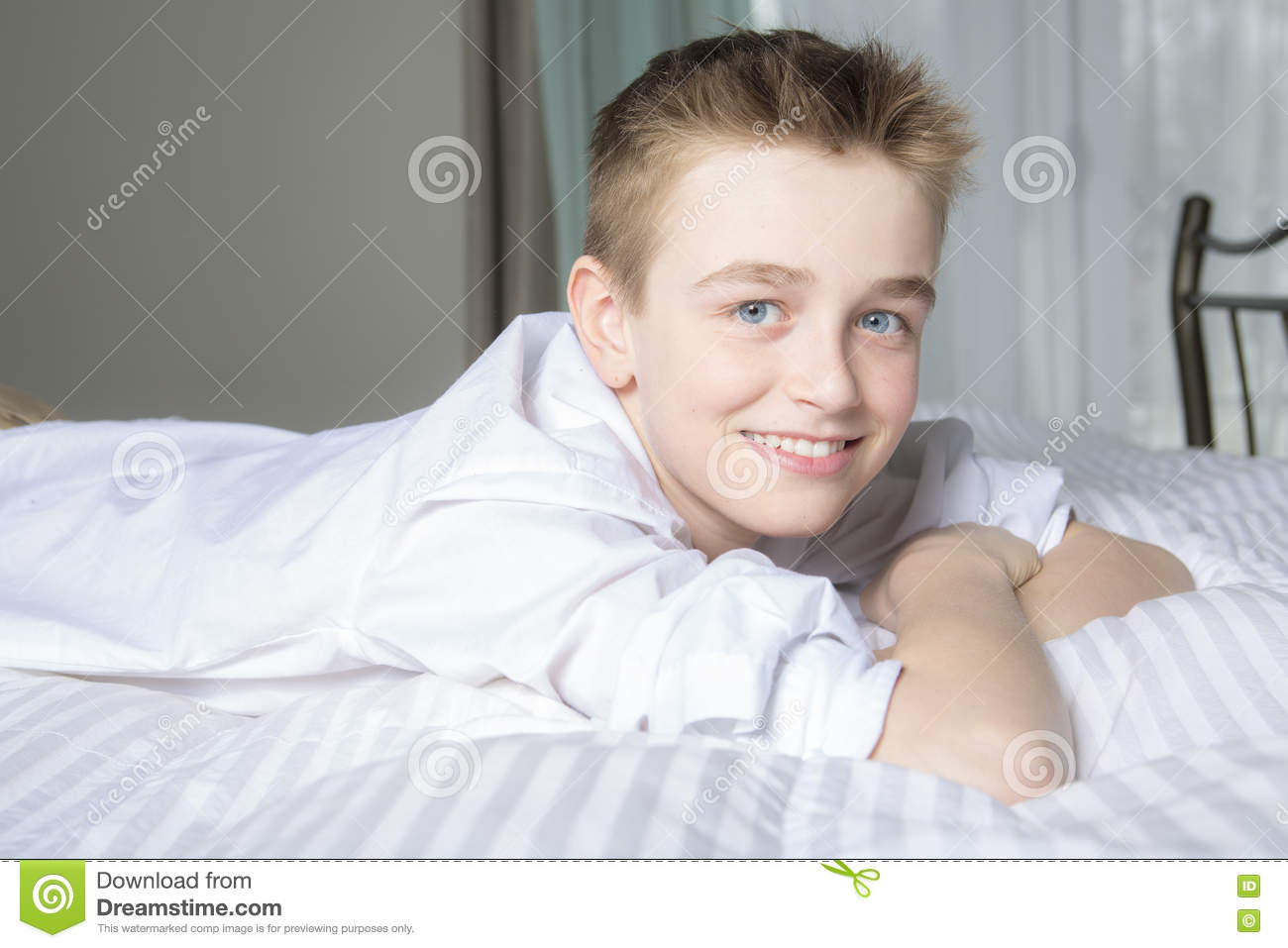 c2105eaf7 Happy Smiling Boy Lying In Bed At Home Stock Image - Image of child ...