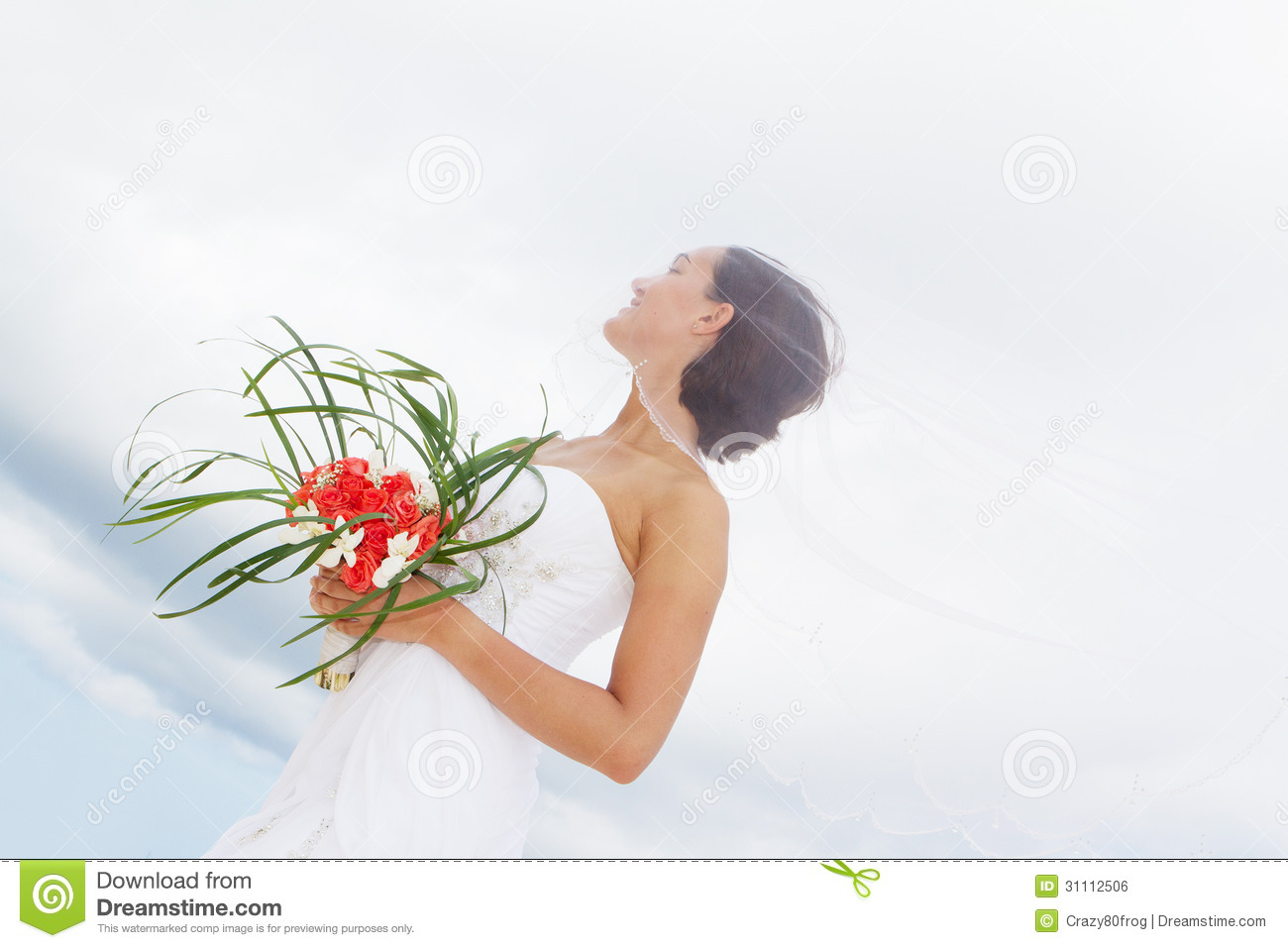 3c883a06b2 Outdoor portrait of young beautiful woman bride in wedding dress on beach
