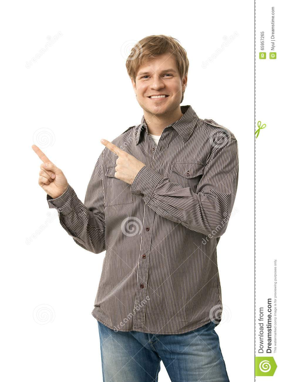 Happy smiling casual man pointing cutout