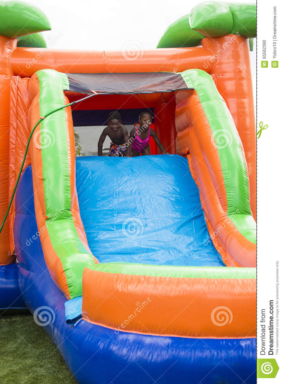 Kids Playing On An Inflatable Slide Bounce House Royalty