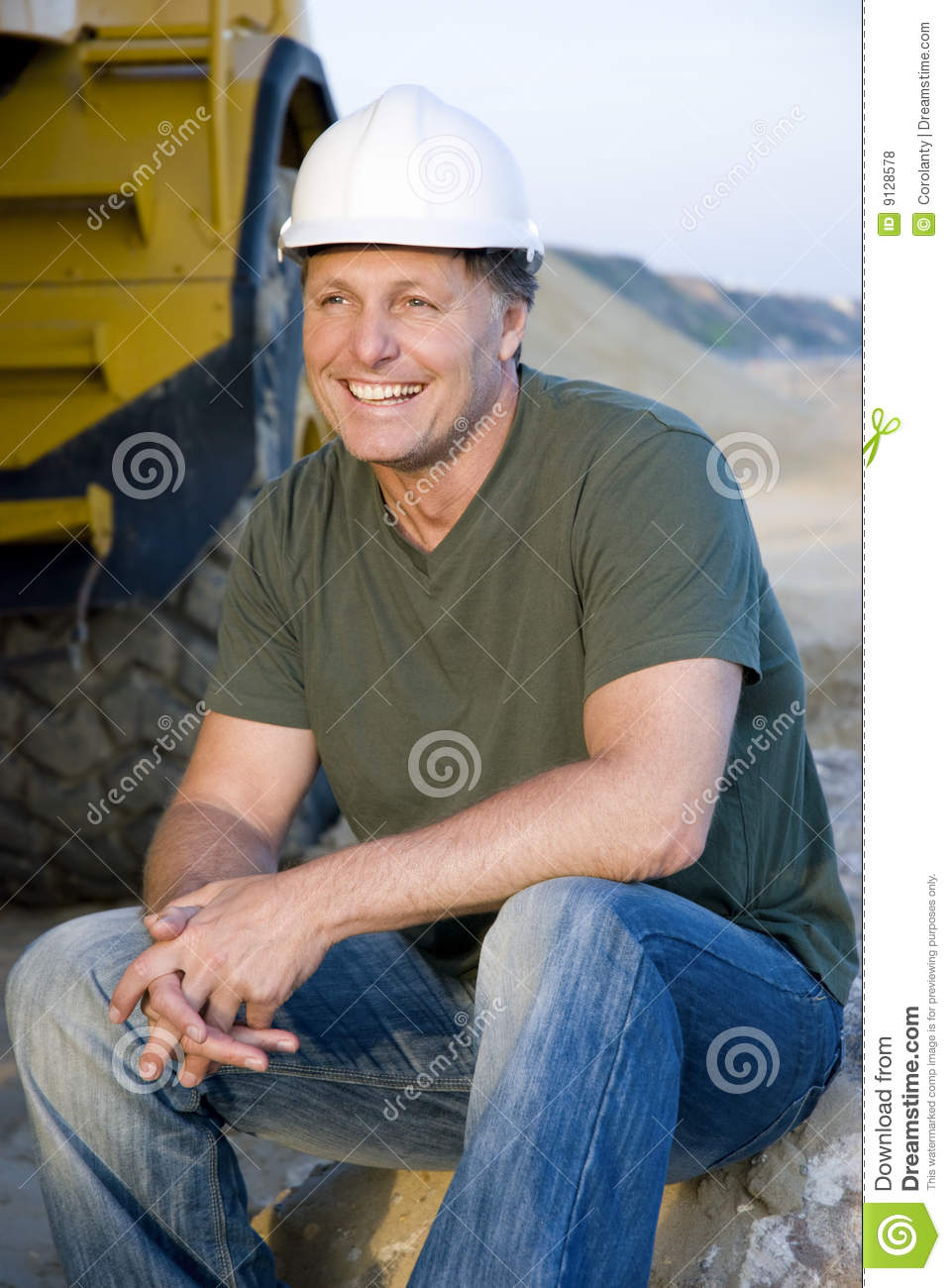 Handsome construction workers take a break