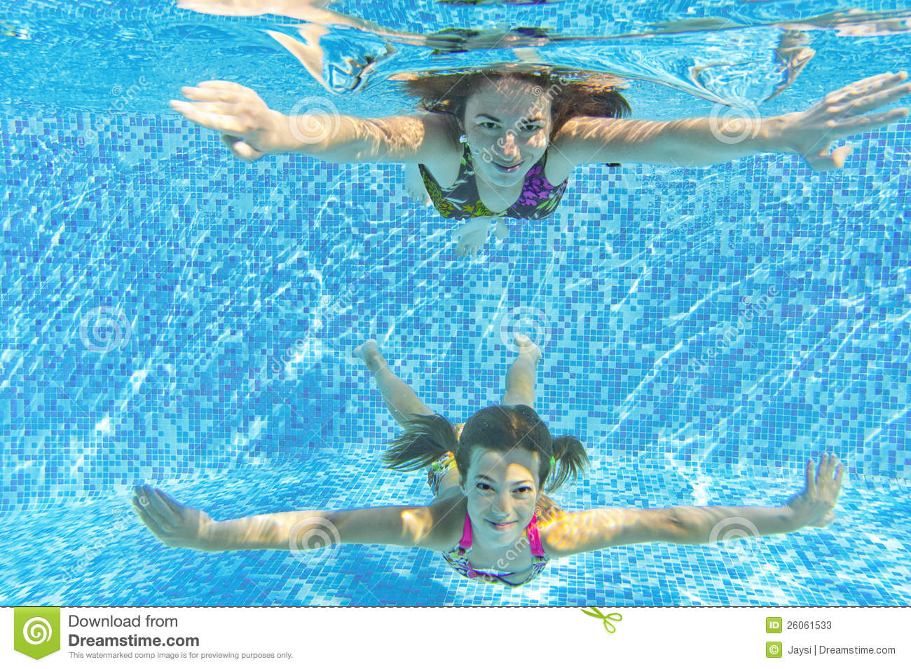 Mother and child swim underwater in pool and having fun kids sport on