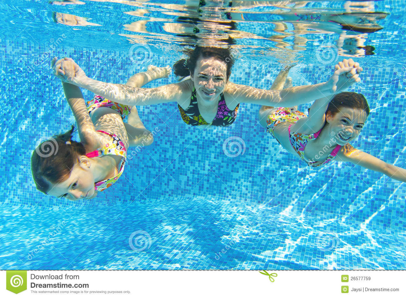 Happy smiling family underwater in swimming pool royalty for Family swimming pool