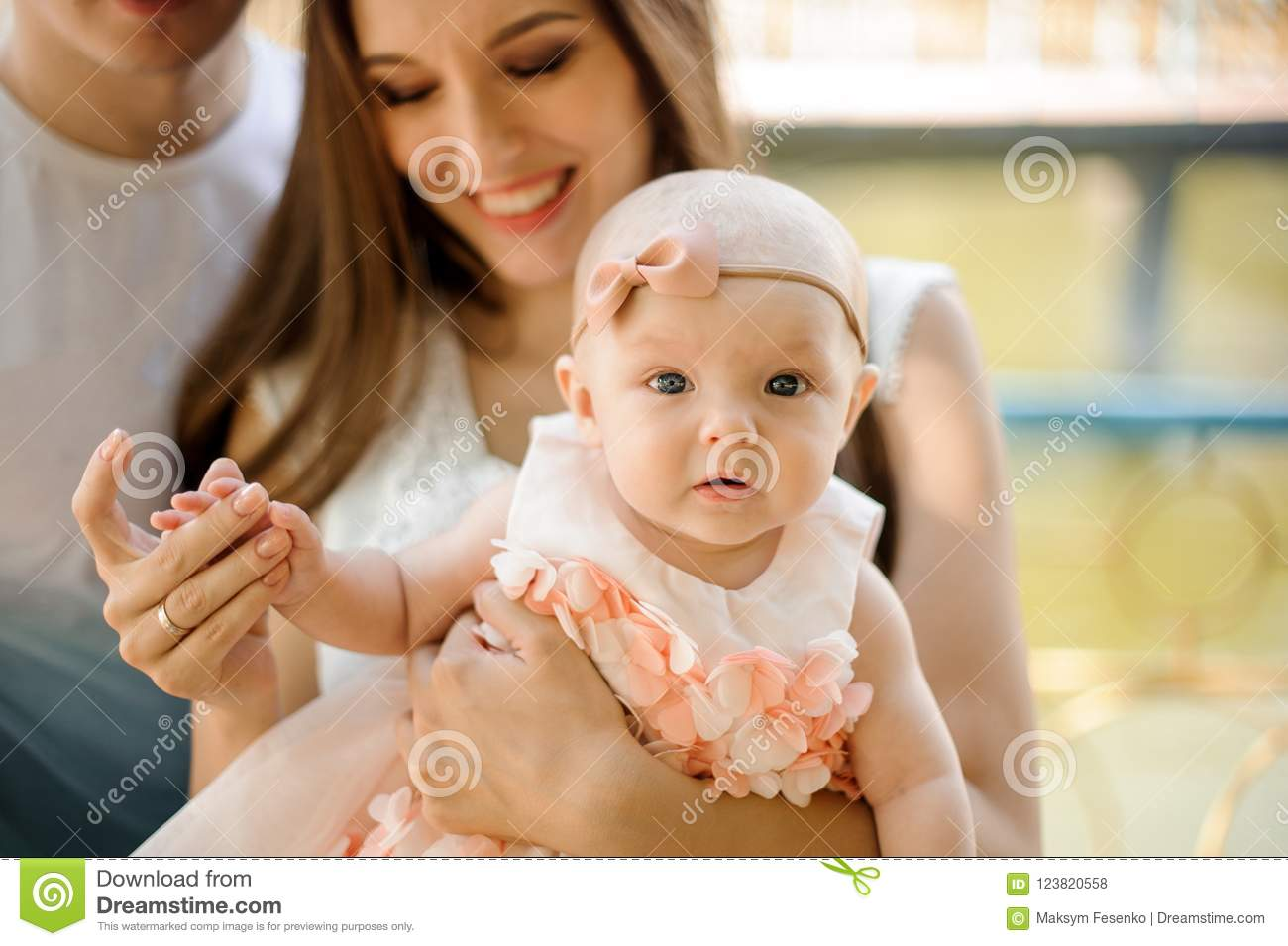 ff8d03d68f Happy Smiling Father And Mother Walking With Cute Baby Girl In P ...