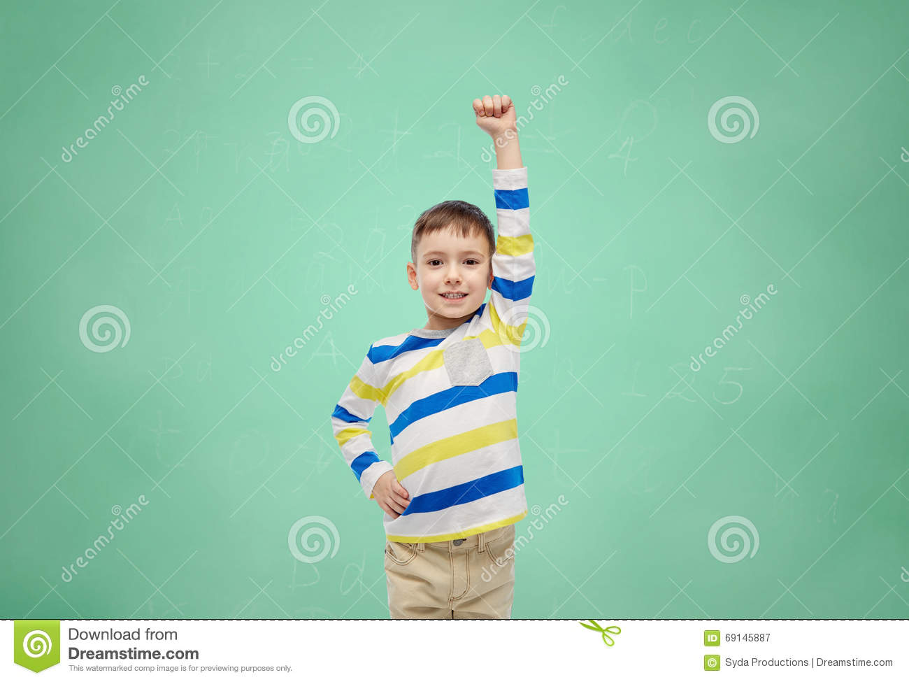acbddd354f015 Childhood, power, education, gesture and people concept - happy smiling little  boy with raised hand over green school chalk board background