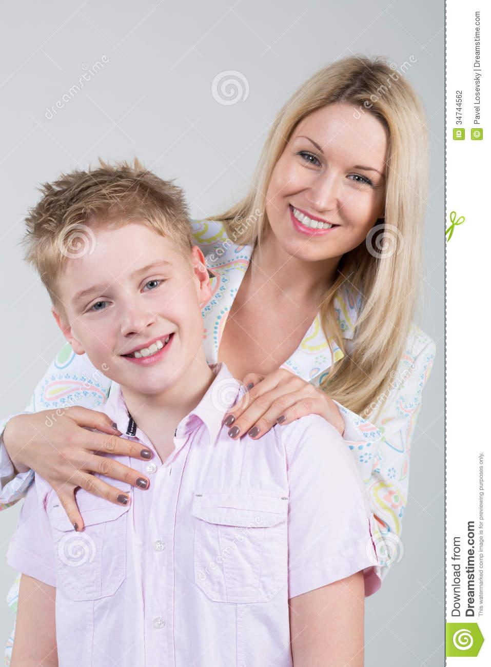 Happy smiling mother hugging young son