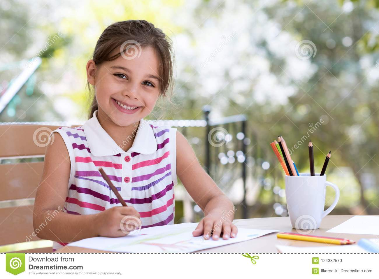 Happy Smiling Preschool Child Girl Drawing Pictures