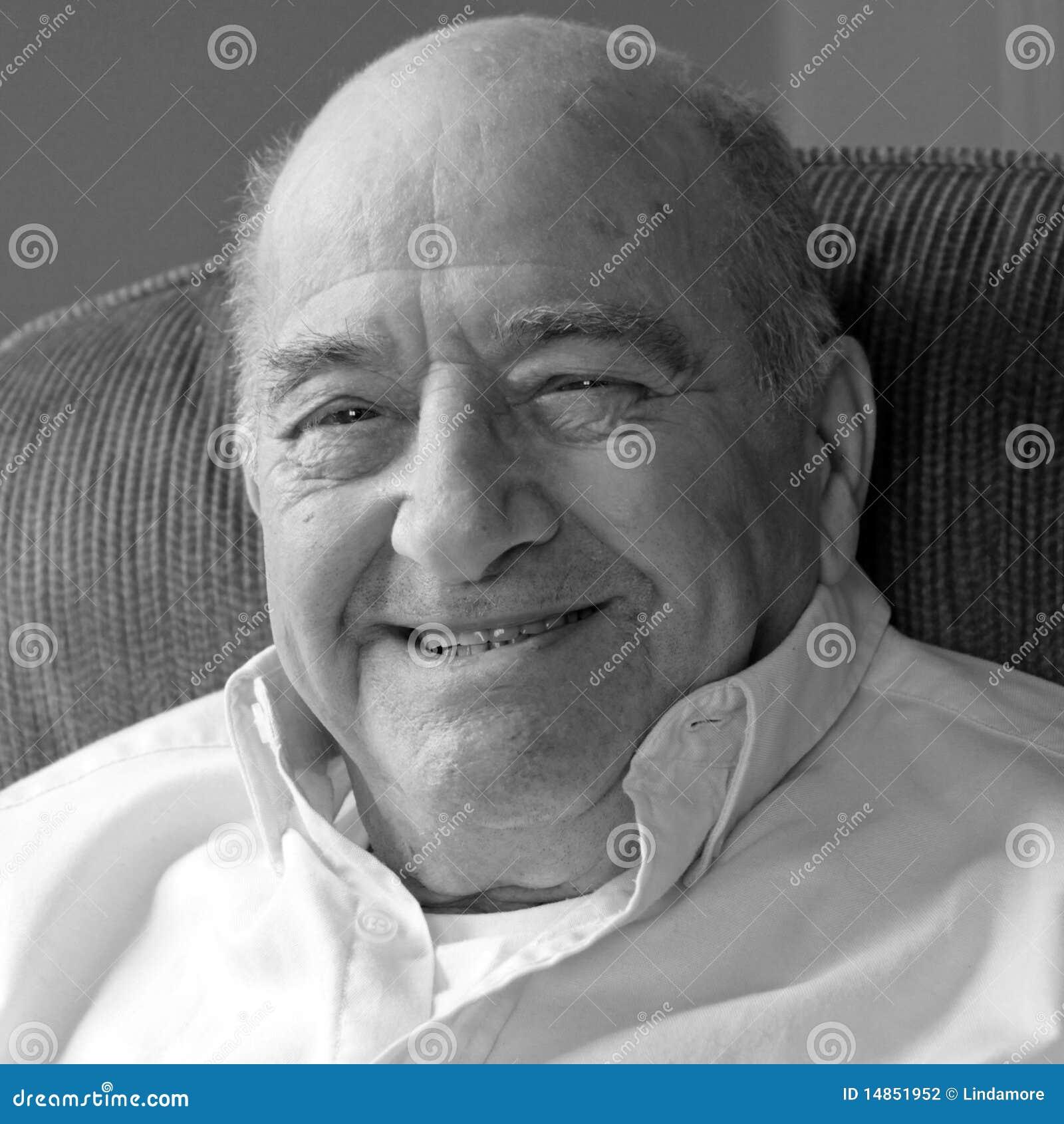 Happy, smiling senior man looking at camera