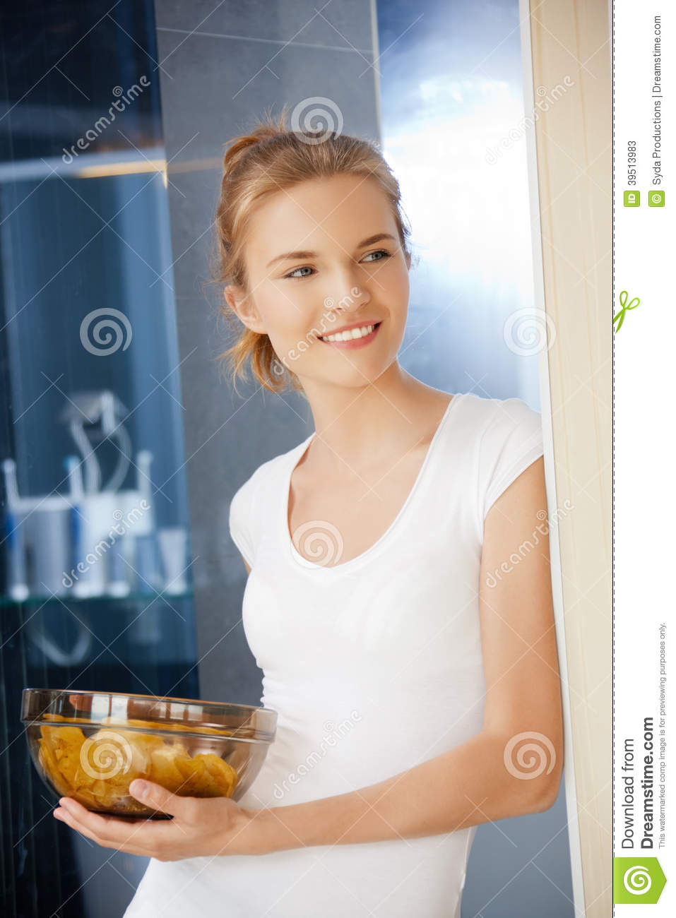 Happy and smiling teenage girl with chips