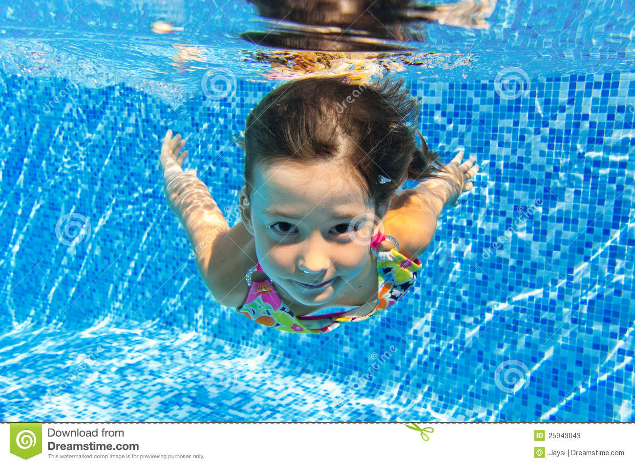 Kids Swimming Underwater happy smiling underwater children in swimming pool royalty free
