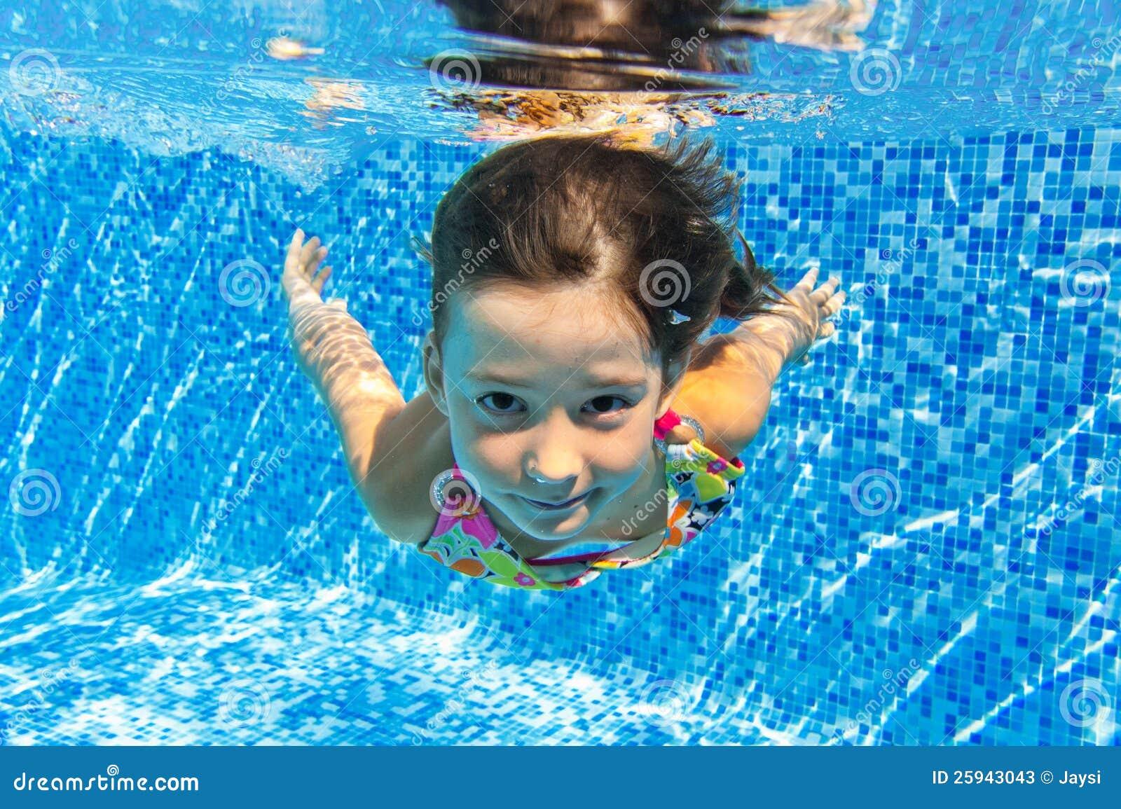 Kids swimming underwater happy smiling underwater child