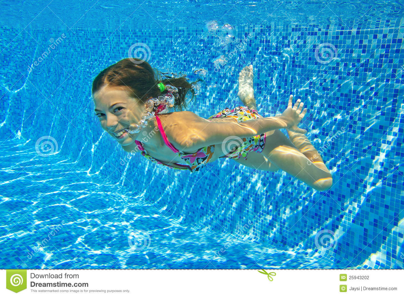 Happy smiling underwater child in swimming pool stock - Swimming pool girl christmas vacation ...