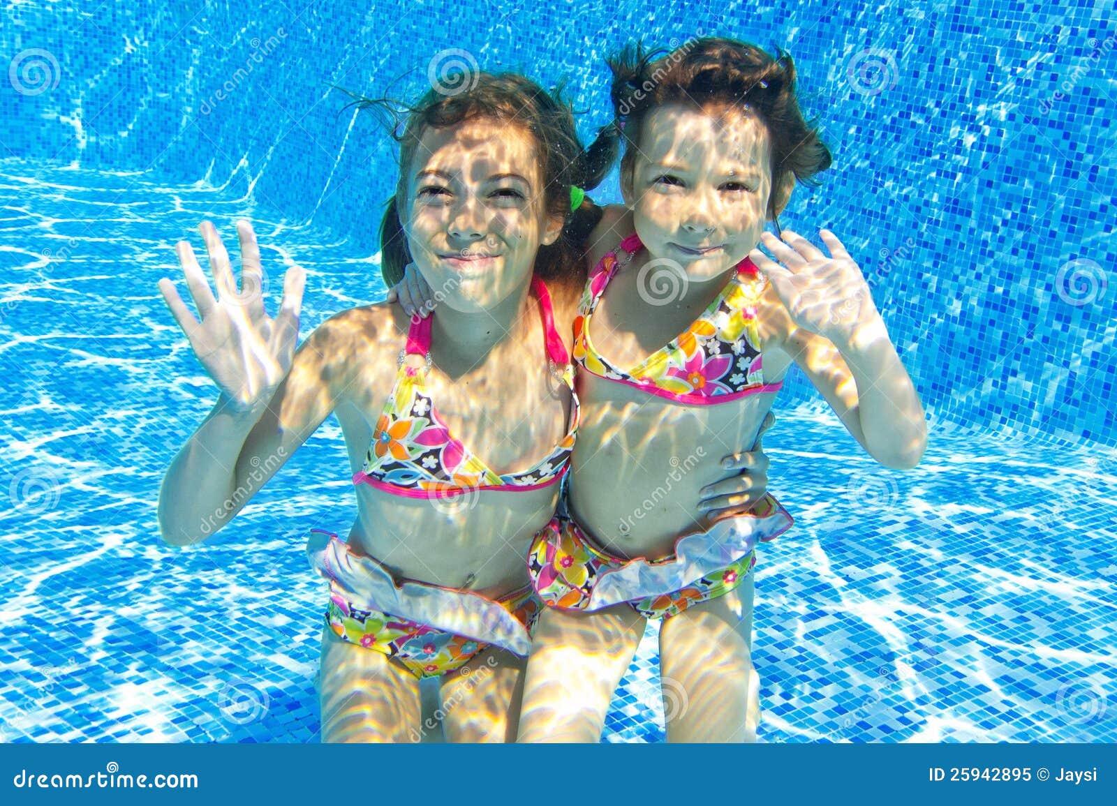 Happy Smiling Underwater Children In Swimming Pool Royalty ...