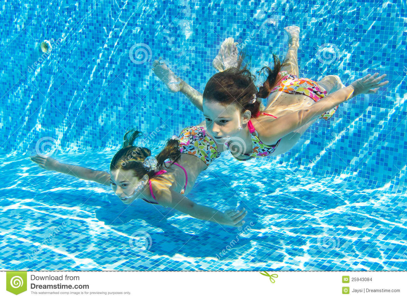 Happy smiling underwater children in swimming pool stock for Swimming pool photos