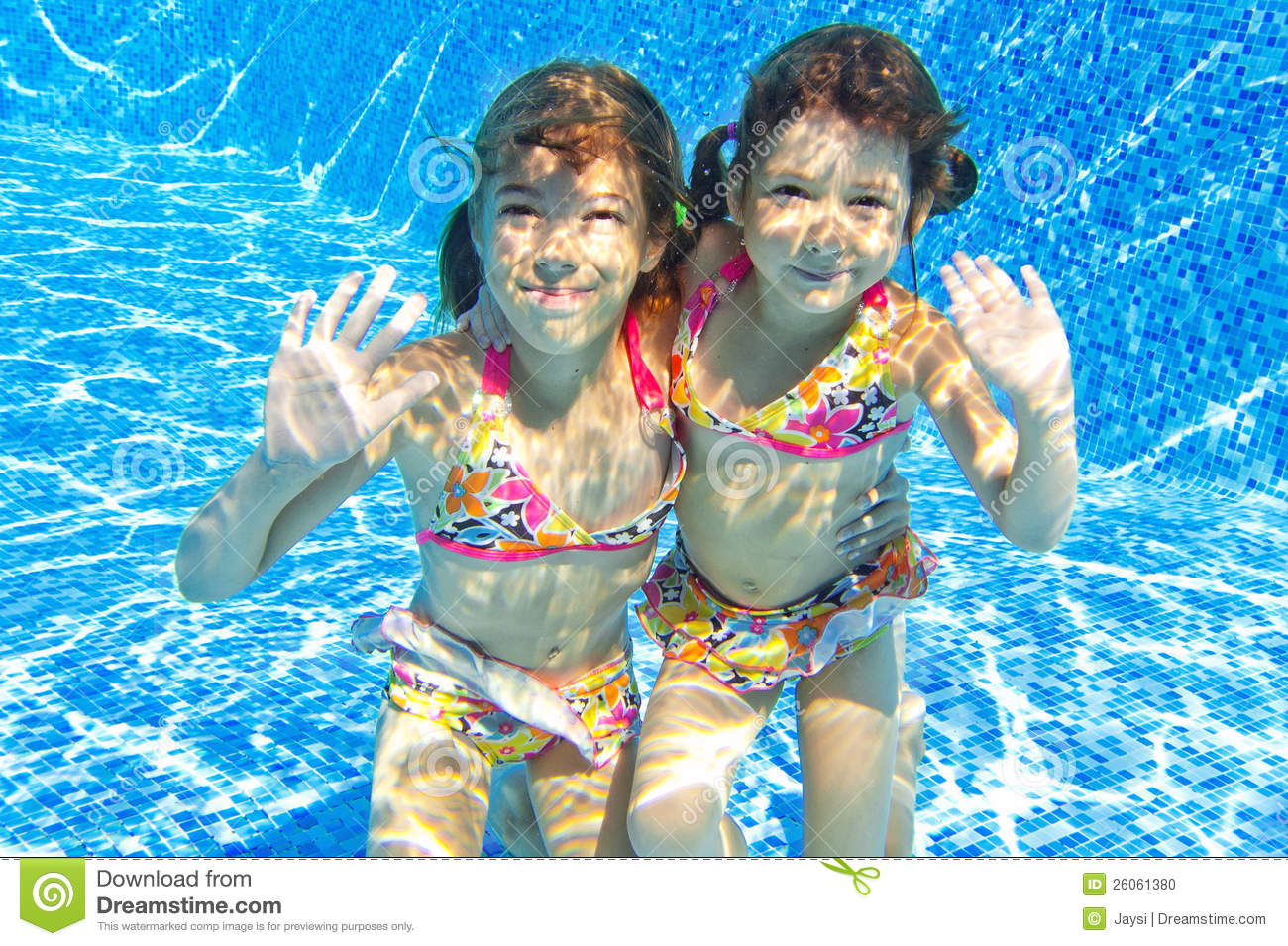 Happy smiling underwater children in swimming pool stock for Kids swimming pool