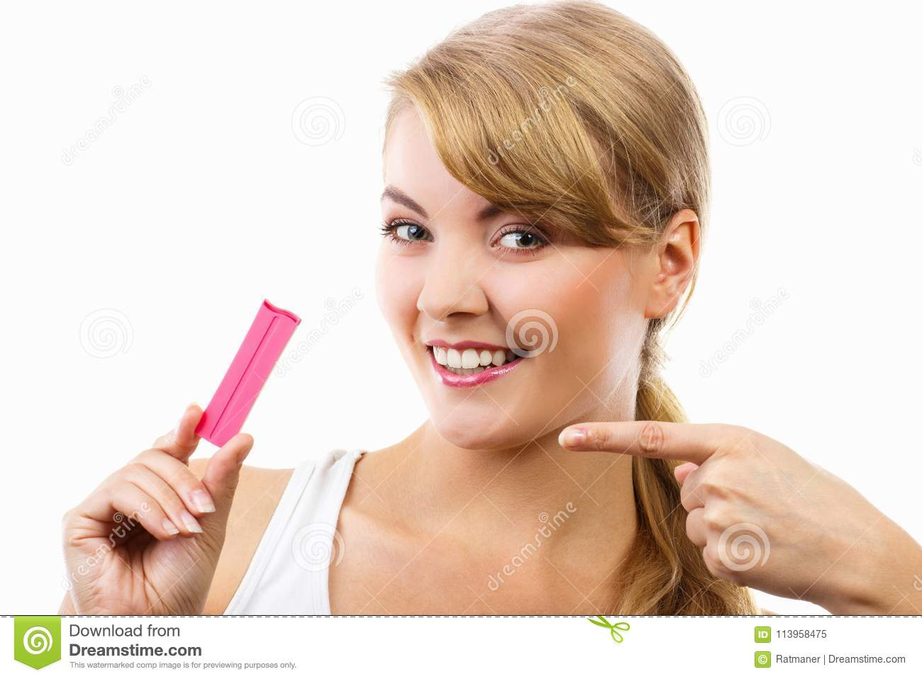 Happy smiling woman holding pregnancy test with positive result
