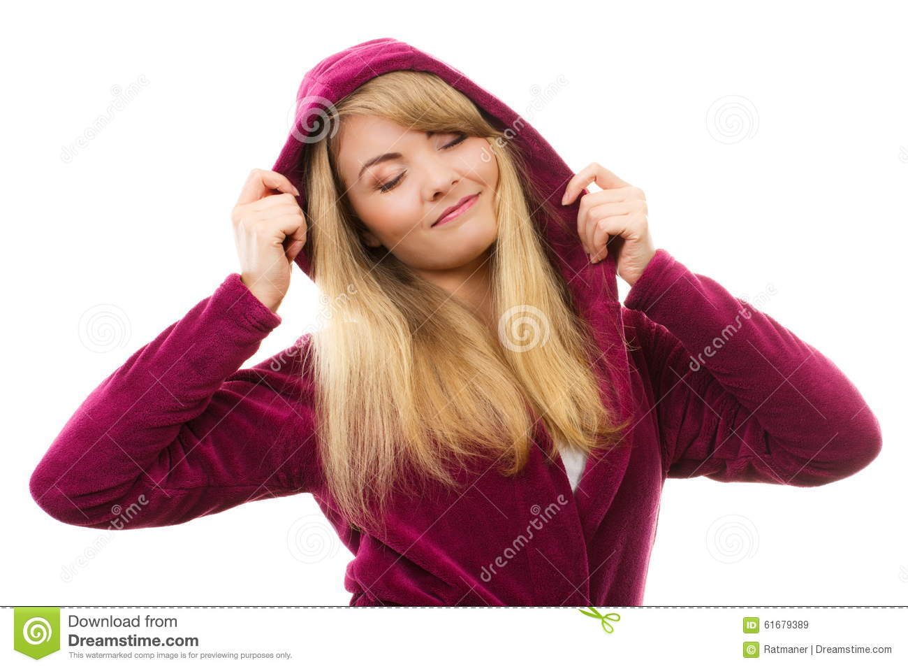Happy smiling woman in purple bathrobe with hood, enjoying freshness and wellbeing