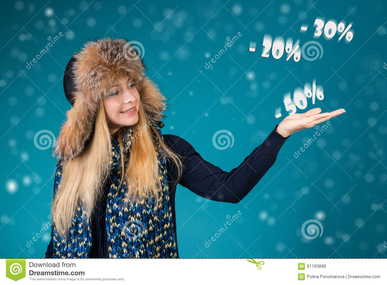 Happy smiling woman showing pointing on discounts 50 , 30 , 20 . Winter sale concept.