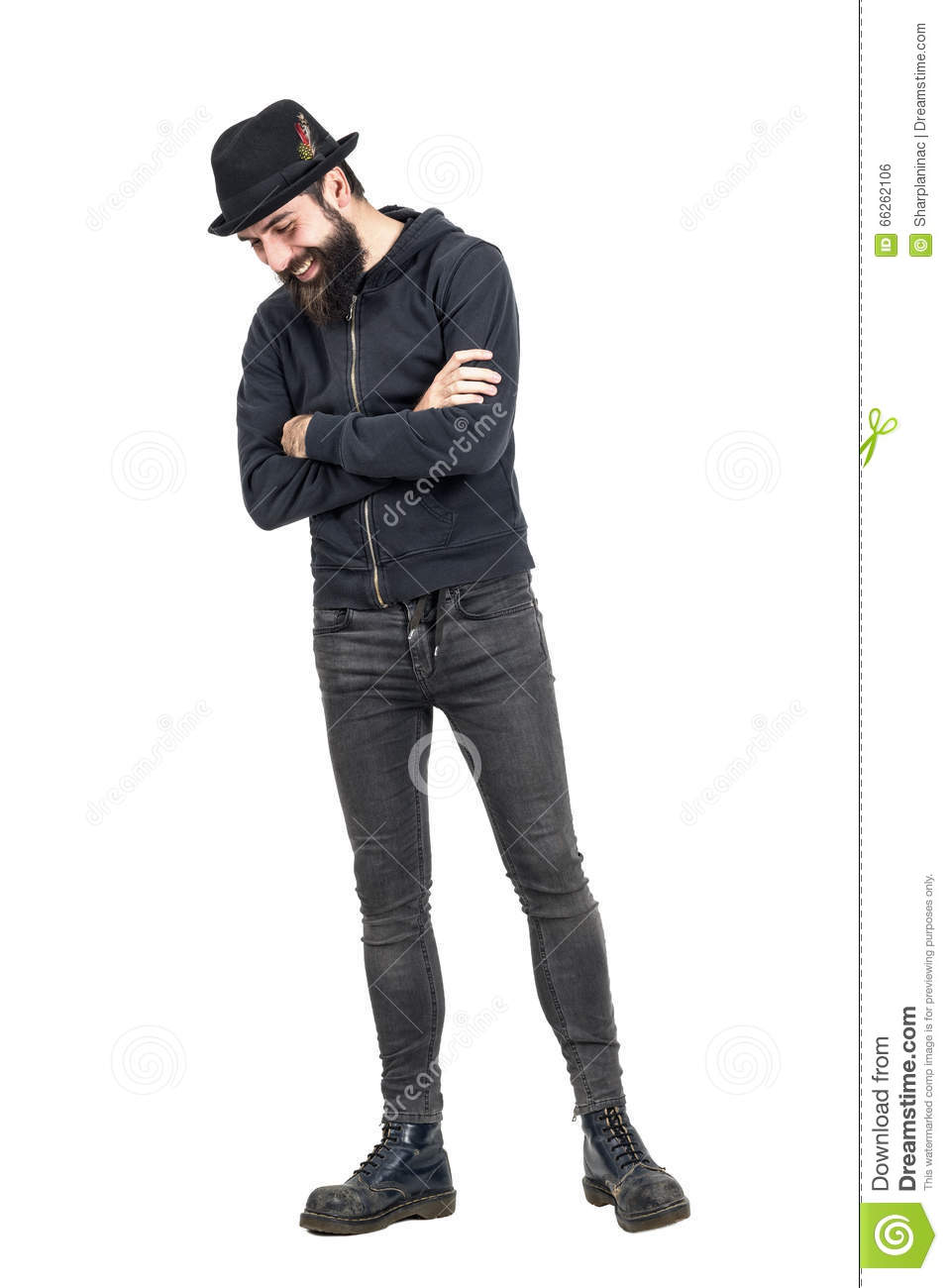 Happy spontaneous laughing hipster with fedora hat looking down