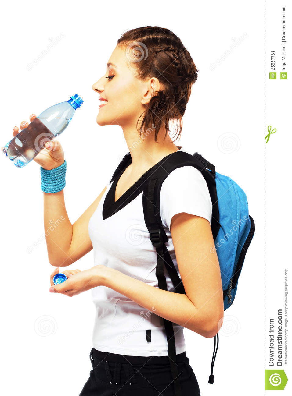 Happy sporty woman is drinking a fresh water