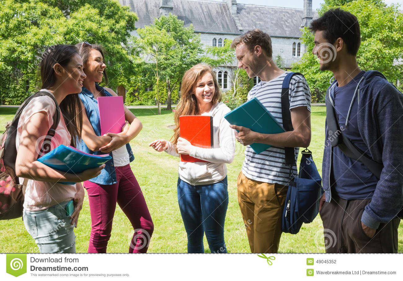 Happy students chatting together outside stock photo image 49045352
