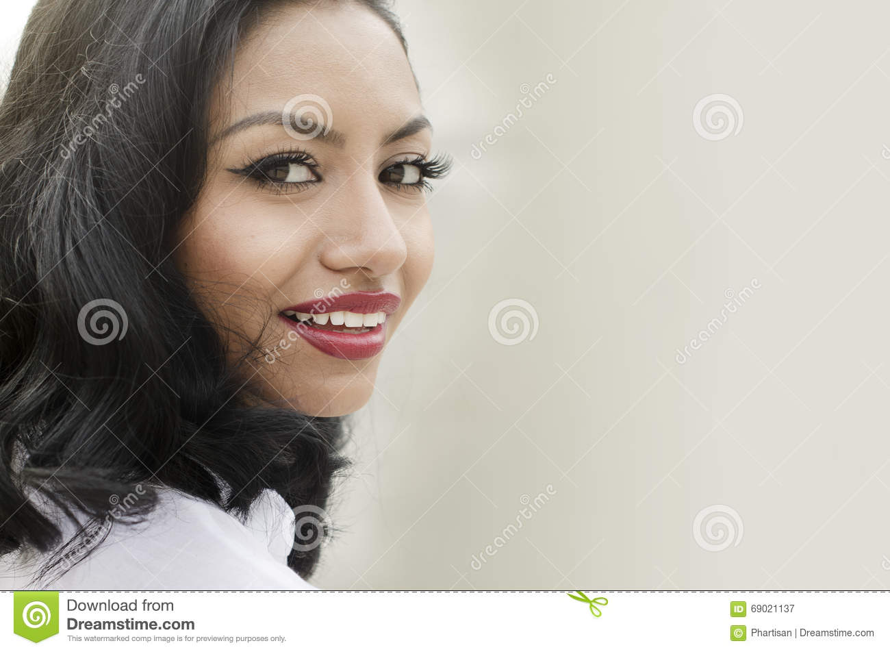 Happy successful smiling young woman