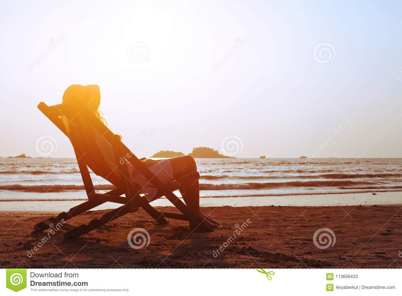 Happy summer beach holidays, woman relaxing in deckchair, tropical vacation