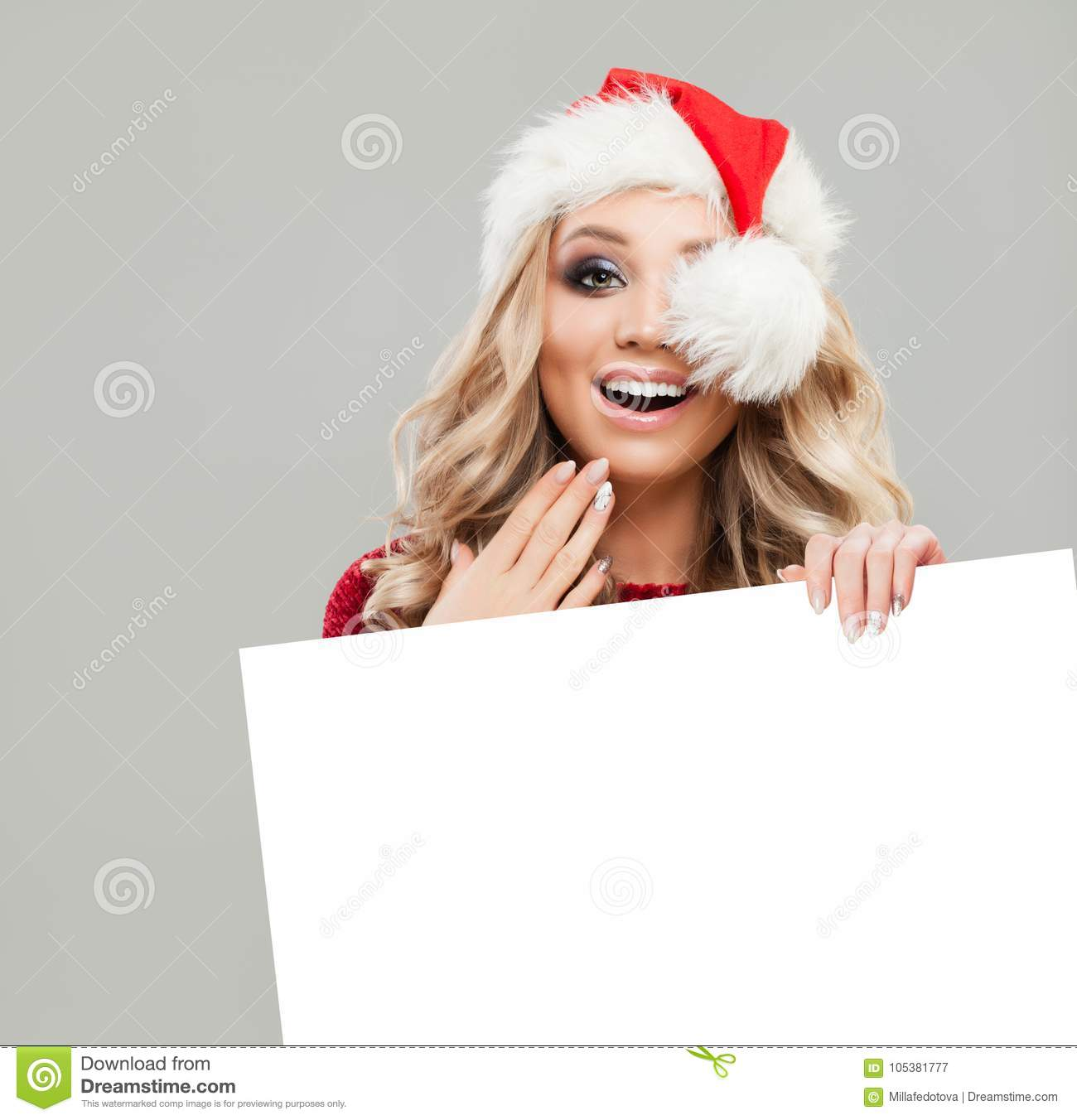 d87388c5020f7 Happy Surprised Christmas Woman Fashion Model holding White Paper Card  Background. Smiling Woman in Santa Hat