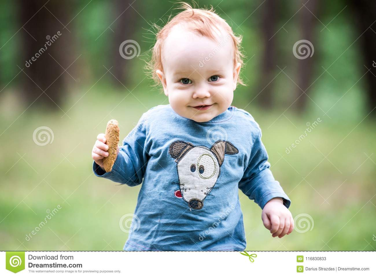 Happy sweet toddler in forest
