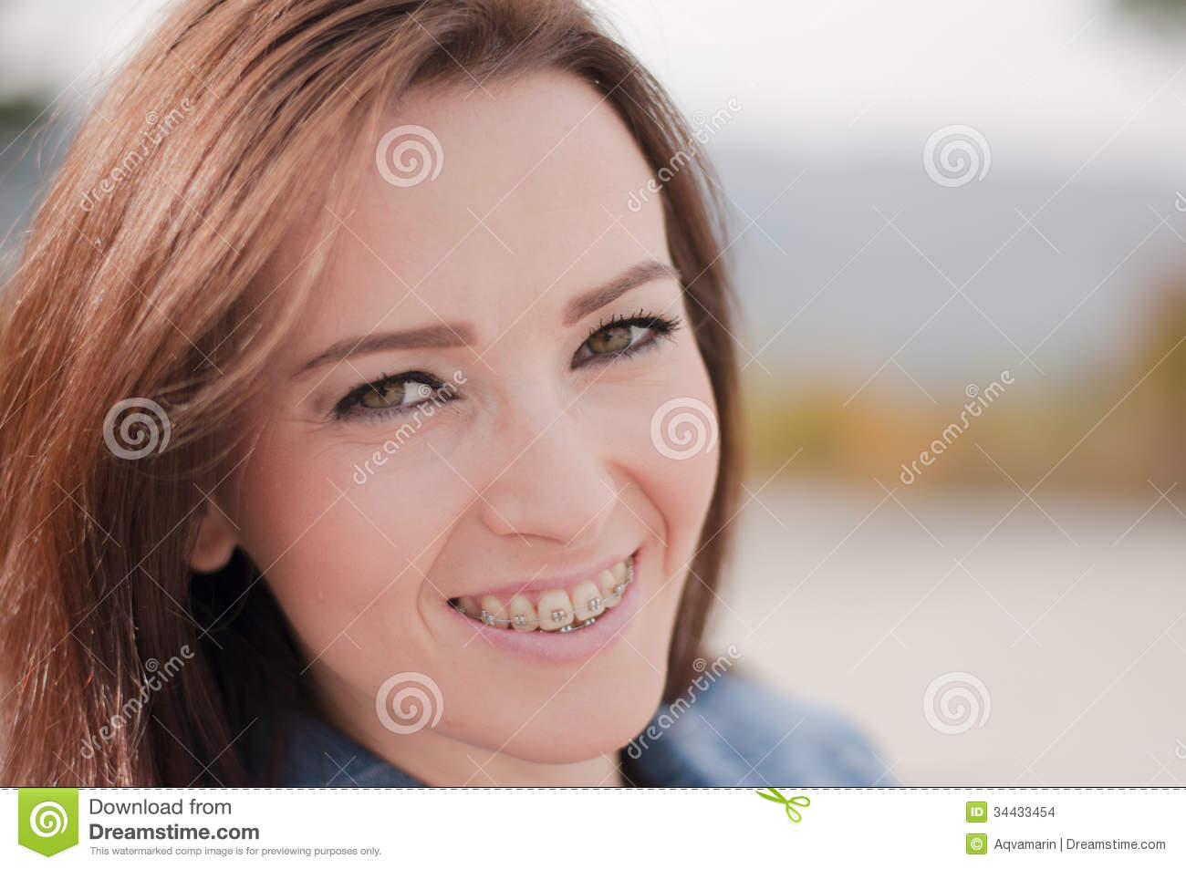 Brunette teen with braces smiling