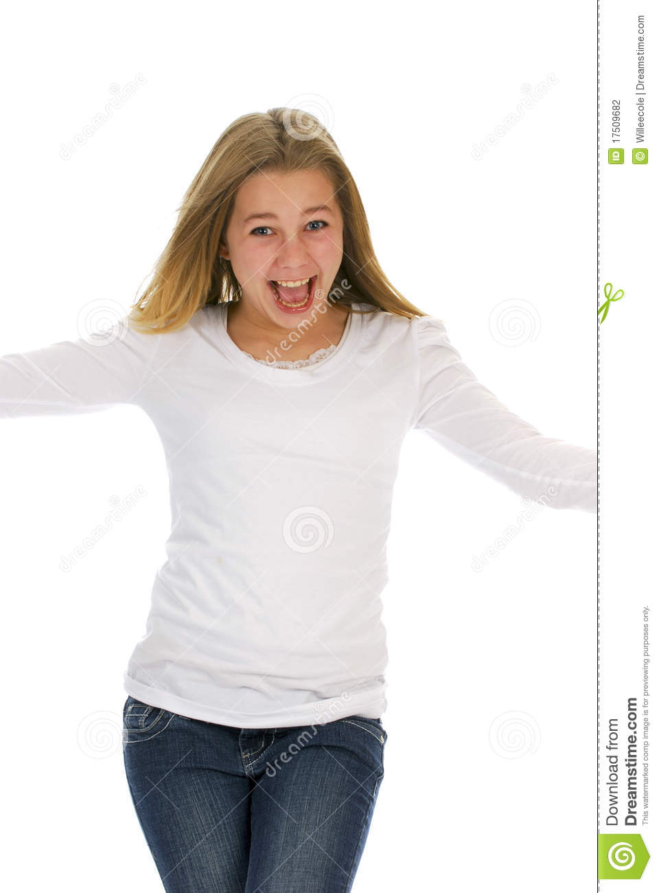 Happy teenage girl with excited expression on white background.