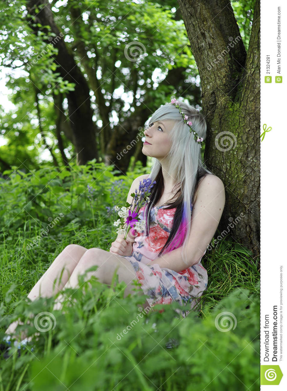 Happy Teen Girl Holding Flowers Stock Image