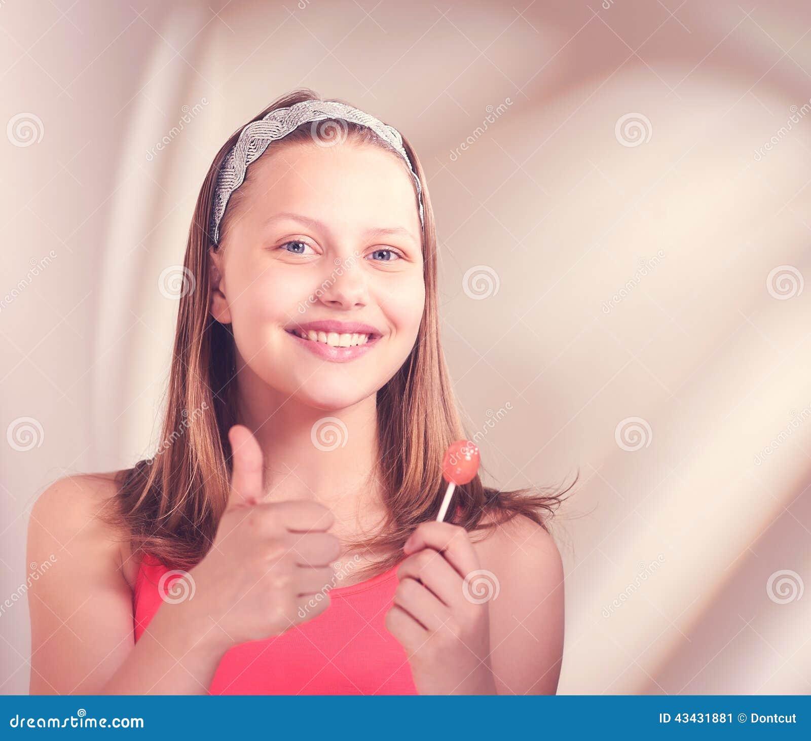 Too happens:) Teen girl with lollipop