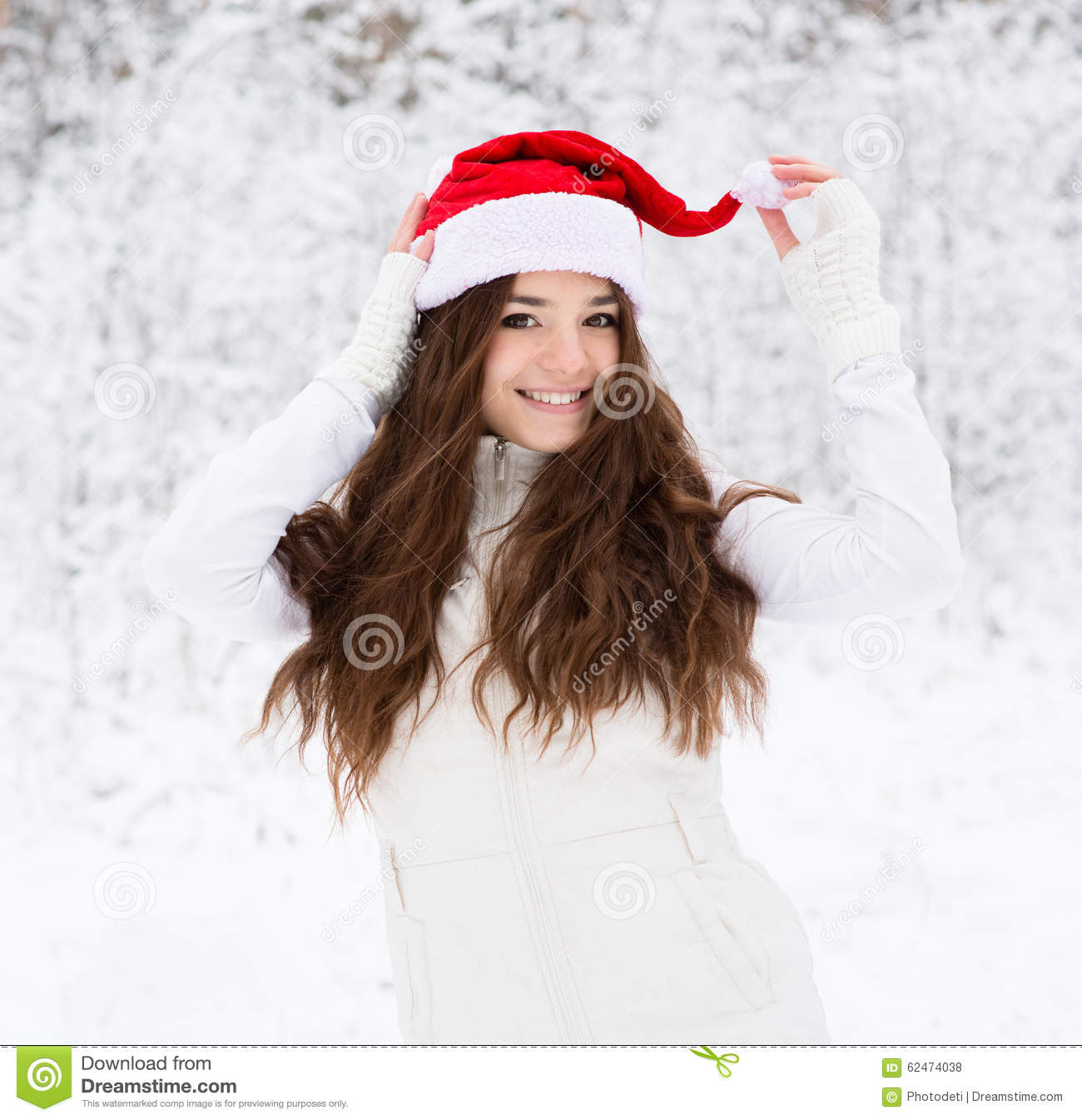 Happy Teen Girl With Red Santa Hat Stock Photo
